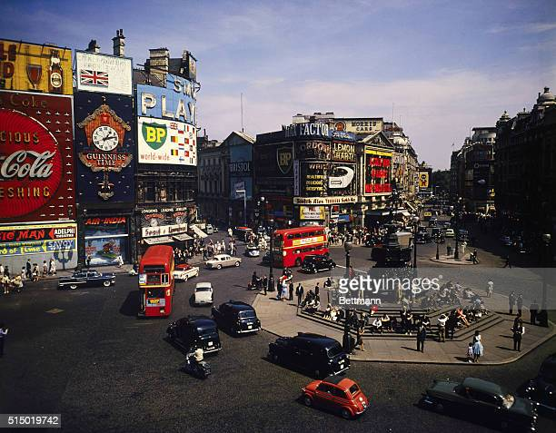 Piccadilly Circus Eros stature center and traffic turning into Shaftesbury Avenue and looking towards Coventry street