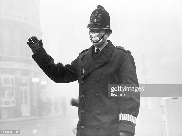 Police constable John Finn on duty at Old Bailey here wears one of the special smog mask issued to members of the London Police force 12/5 in the...
