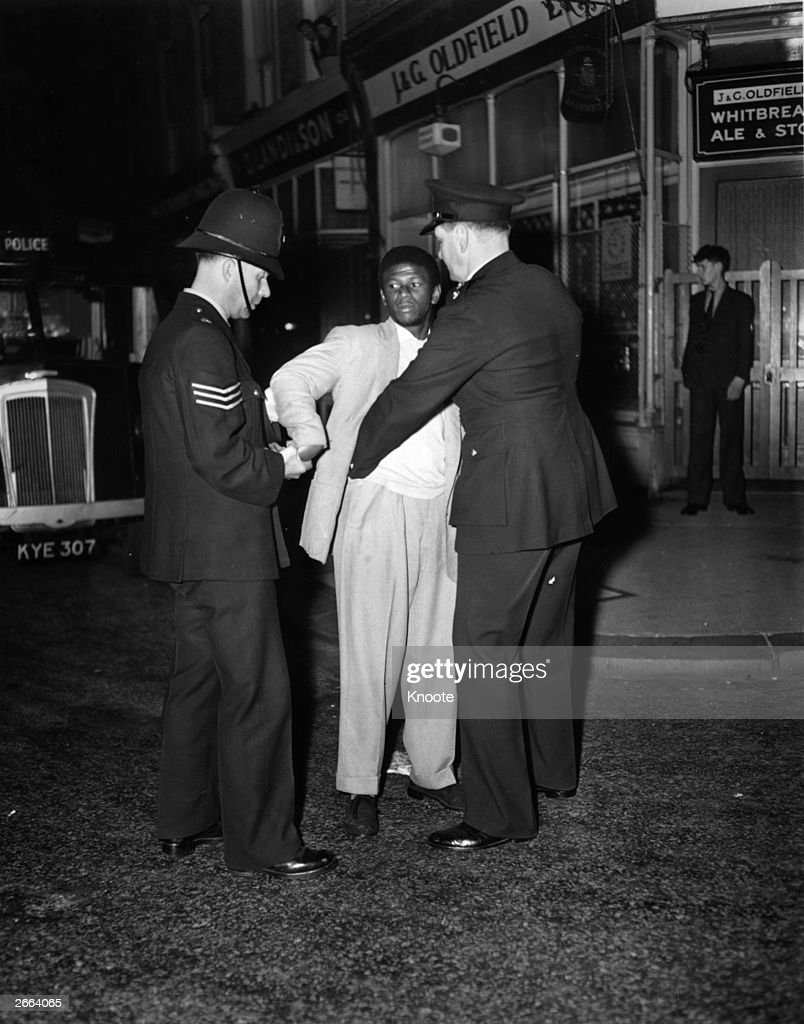 London police search a black youth in Talbot Road, Notting Hill during race riots.