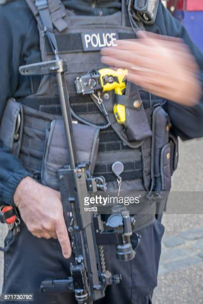 london policeman uniform and equipment - police taser stock pictures, royalty-free photos & images