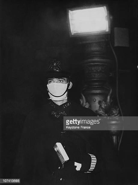 London Policeman Wearing A Mask Against The Fog In United Kingdom