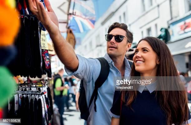 UK, London, Portobello Road, couple on a shopping spree