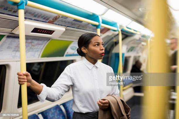 uk, london, portrait of businesswoman in underground train - london underground stock pictures, royalty-free photos & images
