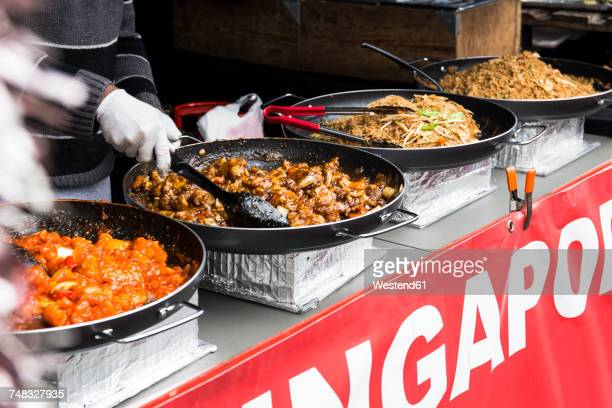 uk, london, preparing asian food on street market - street food stock photos and pictures