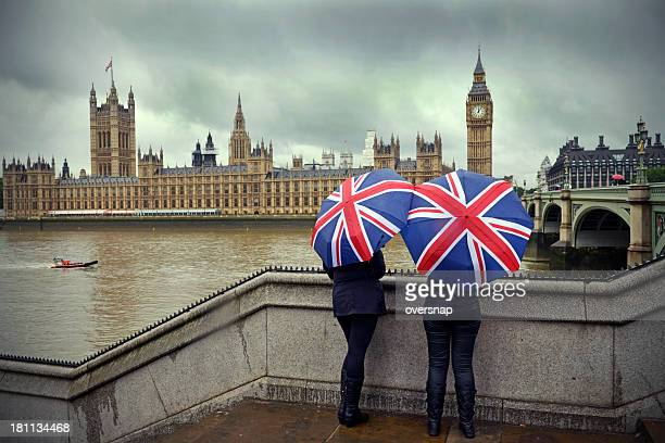 london rain - union jack stock photos and pictures