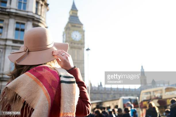 uk, london, rear view of woman wearing a floppy hat looking at big ben - visit stock pictures, royalty-free photos & images