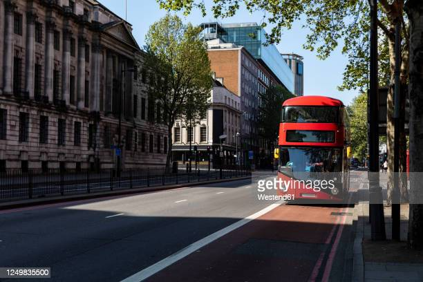 uk, london, red double decker bus on street near euston station - bus stock pictures, royalty-free photos & images