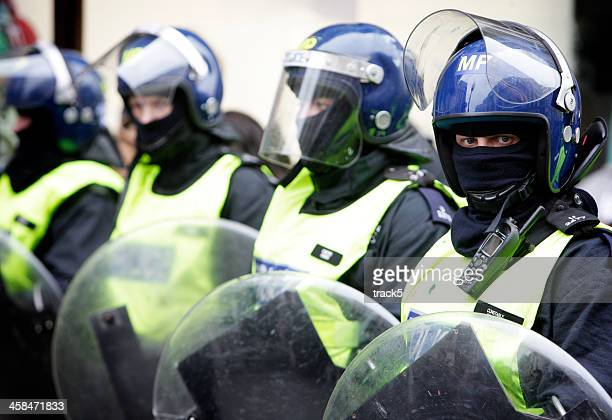 London riot police monitoring the situation.