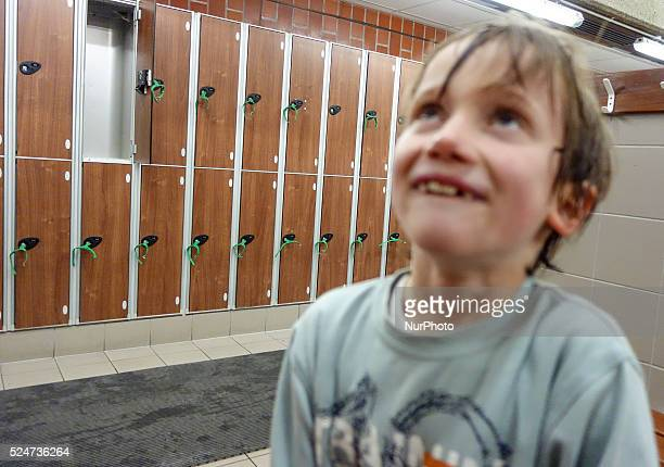London Robin at seven years old in the changing room before his swimming lesson sometime lost his concentration get dressed up focusing his eyes at...