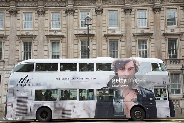 London Routemaster bus Burberry fragrance advertising in London England United Kingdom A large scale picture of a male model adorns the bus as is...