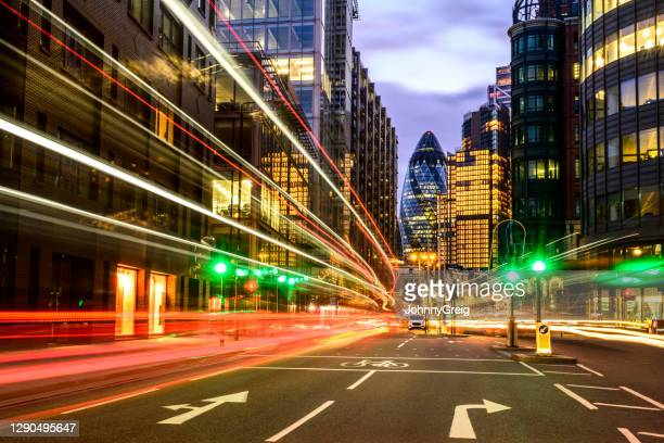 london rush hour light trails at dusk - london stock pictures, royalty-free photos & images