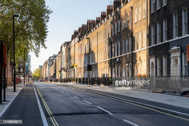 uk, london, shadows on brick buidings in empty street - city stock pictures, royalty-free photos & images