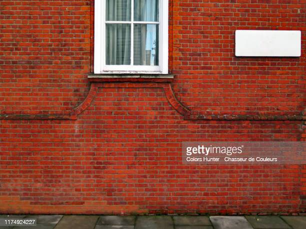 london sidewalk and house brick facade - window stock pictures, royalty-free photos & images