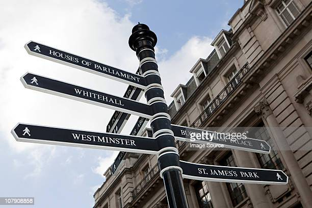 london signpost - whitehall london stock photos and pictures