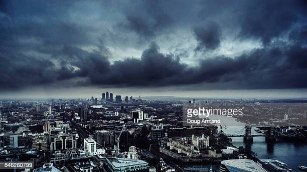 london skyine under a dark brooding sky - storm cloud stock pictures, royalty-free photos & images