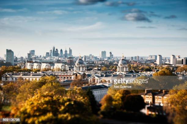 london skyline and the city from greenwich park with the royal naval college - greenwich london stock pictures, royalty-free photos & images