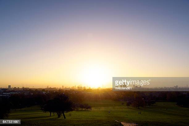 UK, London, skyline as seen from Primrose Hill in backlight