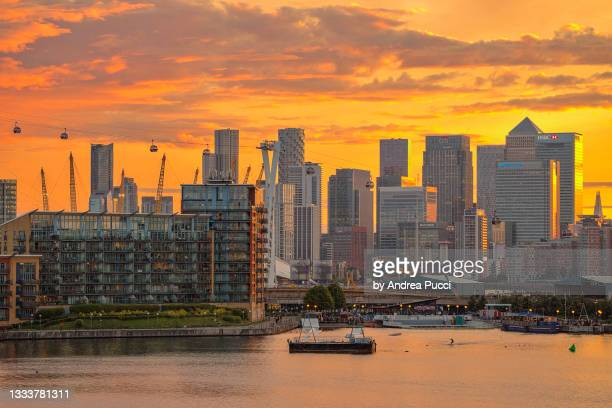 london skyline at sunset from royal victoria dock, london, united kingdom - the o2 england stock pictures, royalty-free photos & images