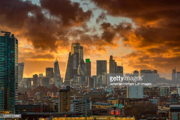 london skyline at sunset - sunset stock pictures, royalty-free photos & images