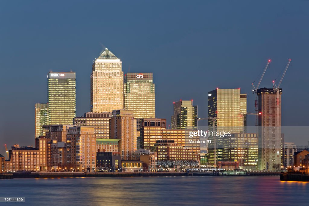 UK, London, skyline of Canary Wharf at River Thames at dusk : Stock Photo