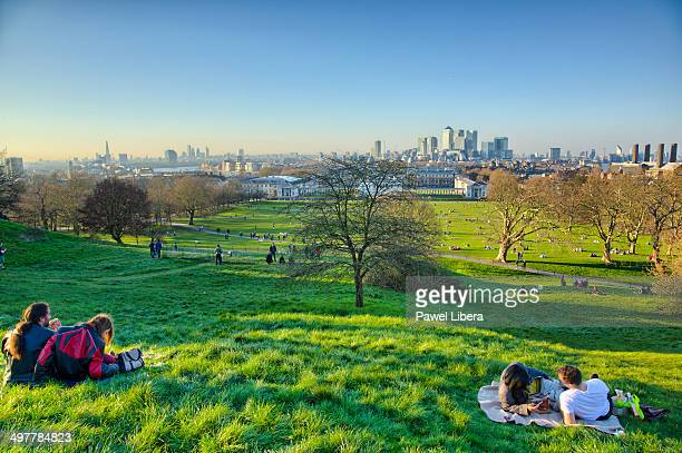 london skyline seen at sunset from greenwich park. - greenwich london stock pictures, royalty-free photos & images