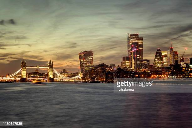 london skyline tower bridge and city of london at night - central london stock pictures, royalty-free photos & images