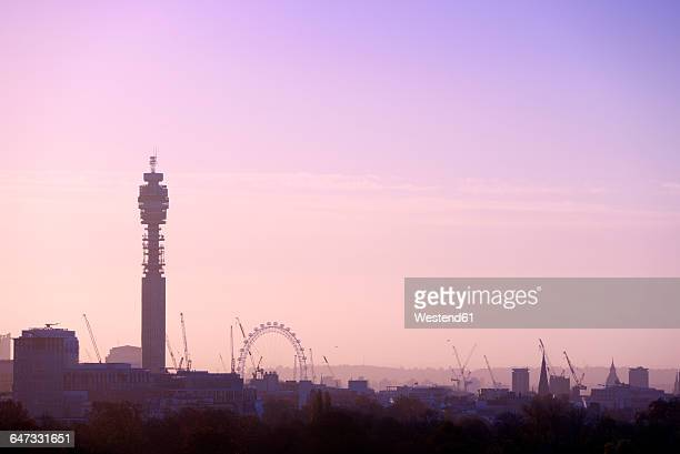 UK, London, skyline with BT Tower and London Eye in morning light