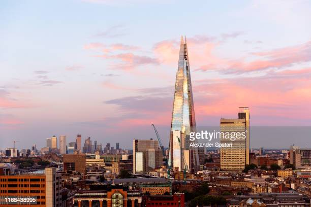 london skyline with shard skyscraper during sunset, england, uk - shard london bridge stock pictures, royalty-free photos & images