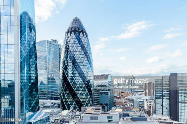 london skyline with the gherkin skyscraper reflecting in glass skyscrapers, england, uk - skyline stock pictures, royalty-free photos & images