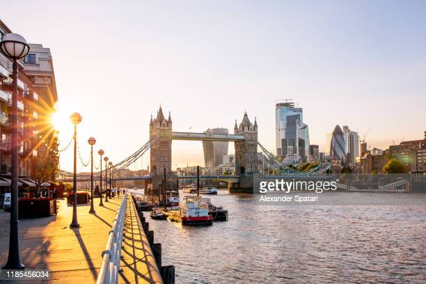 london skyline with tower bridge and skyscrapers of london city at sunset, england, uk - london fotografías e imágenes de stock