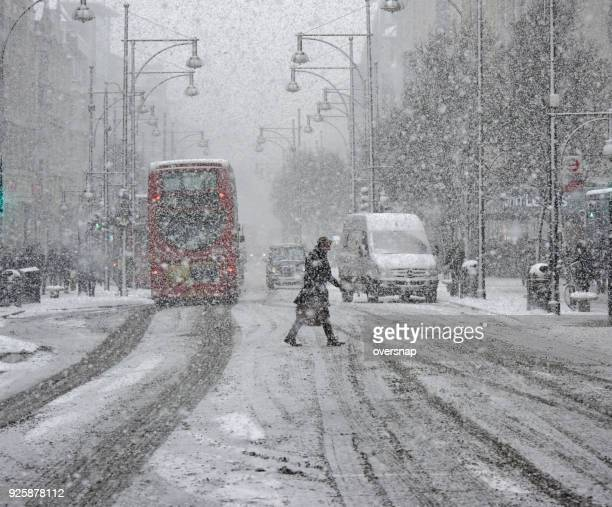 london snow storm - oxford street london stock photos and pictures