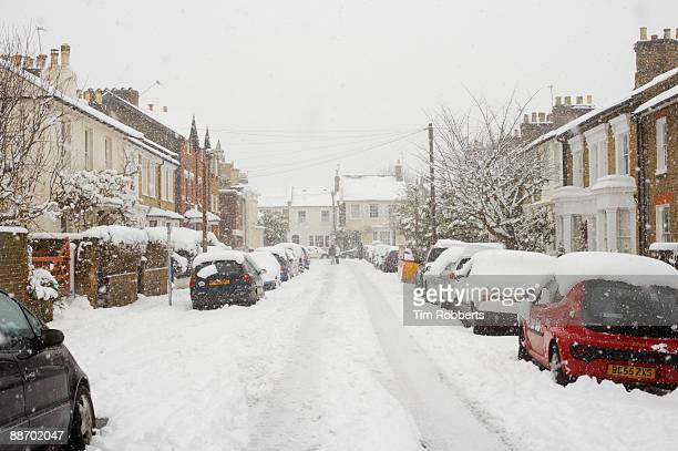A London Street covered in snow whilst snowing