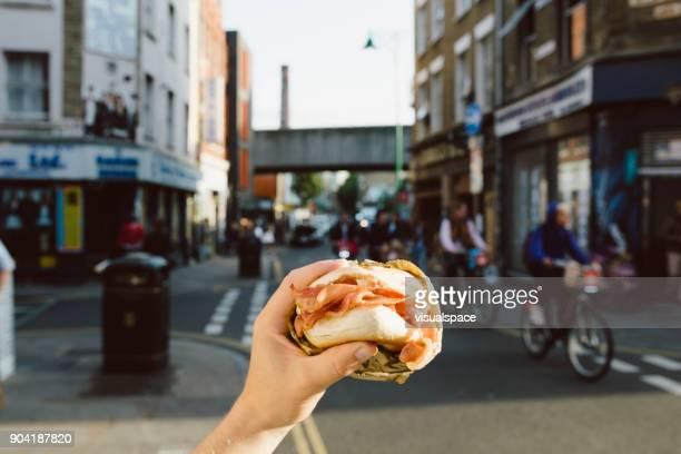 london street food - bagel - east london stock pictures, royalty-free photos & images