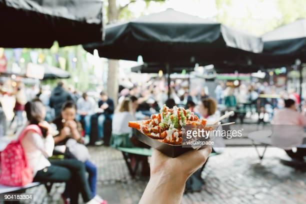 london street food - guacamole fries - street food stock pictures, royalty-free photos & images
