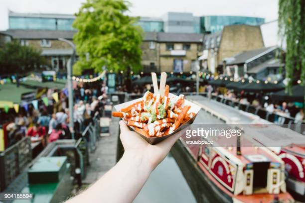 london street food - guacamole fries - camden london stock pictures, royalty-free photos & images