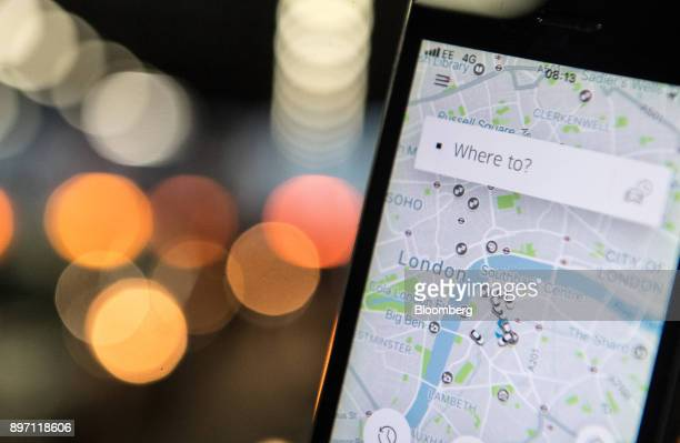 A London street map sits on a smartphone using the Uber Technologies Inc ridehailing service smartphone app in this arranged photograph in London UK...
