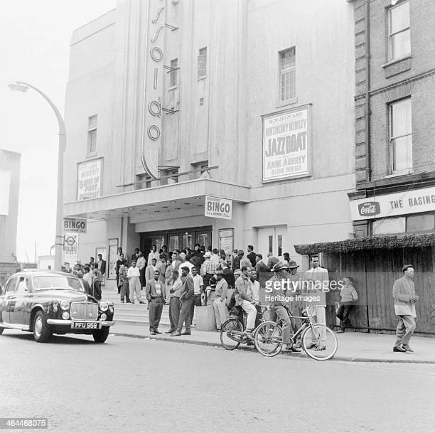 London street scene 1961 A crowd of people standing outside the Essoldo