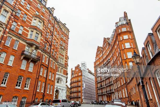 London street with red brick buildings in Kensington and Chelsea district in London, England, UK