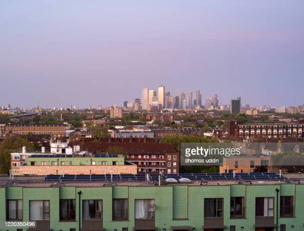 london suburb and the city skyline at dusk - flat stock pictures, royalty-free photos & images