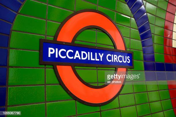 london, subway sign, piccadilly subway station - underground sign stock pictures, royalty-free photos & images