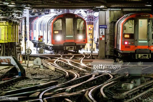 London subway system trains on merging crossing tracks