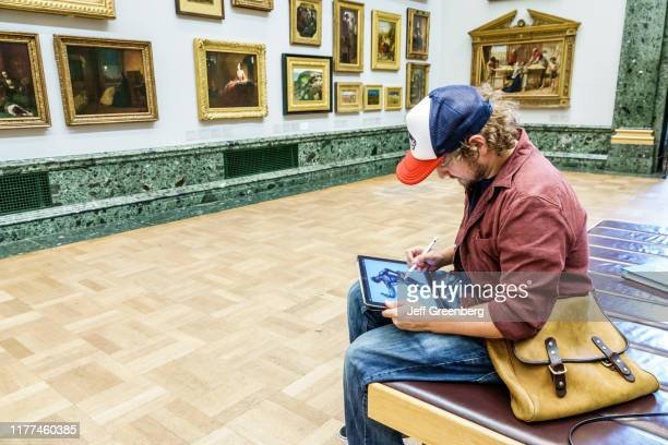 London Tate Britain art museum artist with iPad copying masters