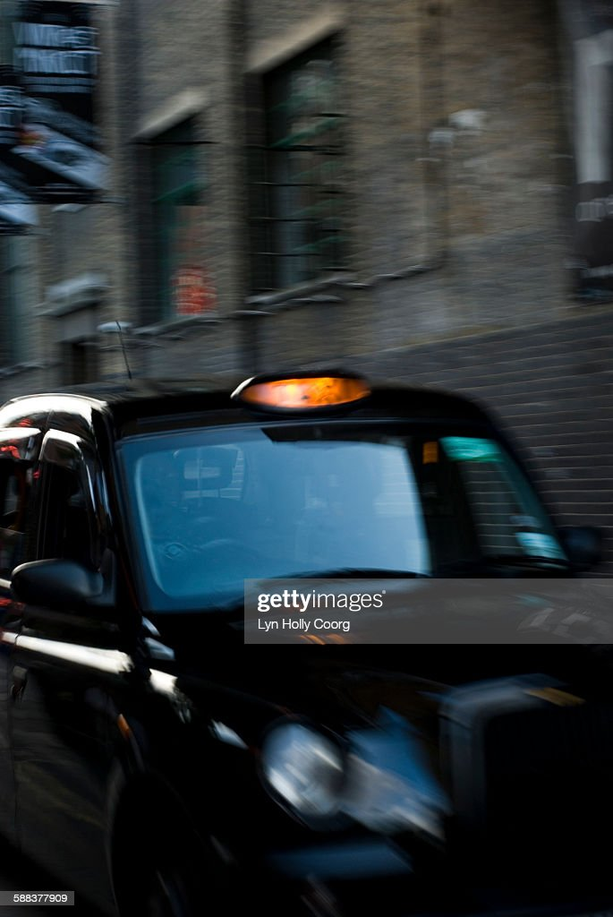 London taxi and building at dusk : Stock Photo