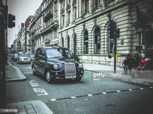 London taxi cab or hackney carriage in London city street traffic