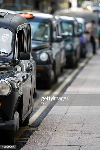 London taxi cabs line up in Canary Wharf