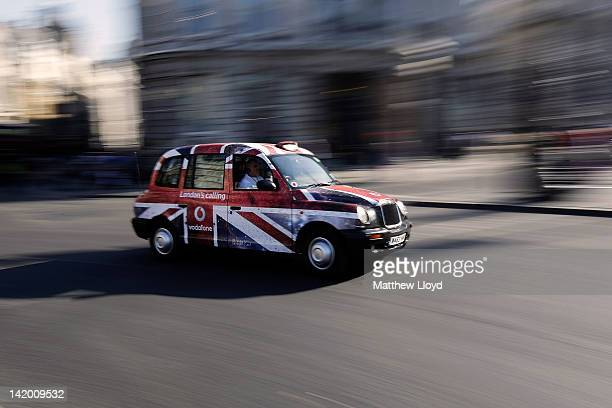 London taxi cabs travel round Trafalgar Square on March 28 2012 in London England London's transport system will be stretched to its limits during...