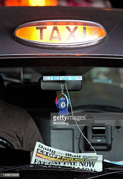 A London taxi light is lit showing it is available for a fare in London UK on Friday May 4 2012 Olympic tourists seeking to hire one of London's 9000...