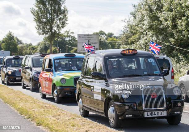 London taxis carrying veterans arrive at the Pegasus Bridge Museum for a service to commemorate the 73rd anniversary of the DDay landings on June 5...