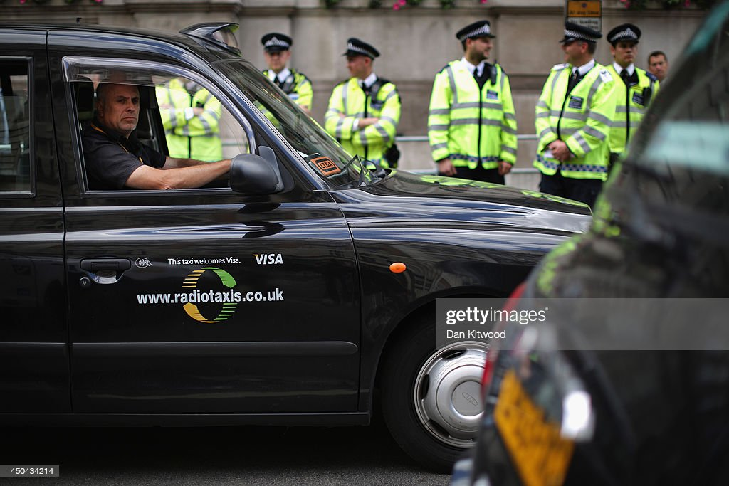 London taxi's line up on Whitehall during a protest against a new smart phone app, 'Uber' on June 11, 2014 in London, England. London's licensed black taxi drivers are campaigning against the introduction of the 'Uber' taxi smartphone app in the United kingdom. Drivers say that there is a lack of regulation behind the new app.