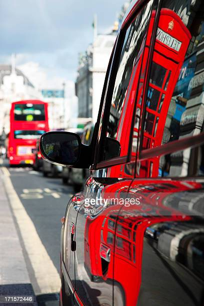 london telephone box reflected in taxi cab side - international landmark stock pictures, royalty-free photos & images